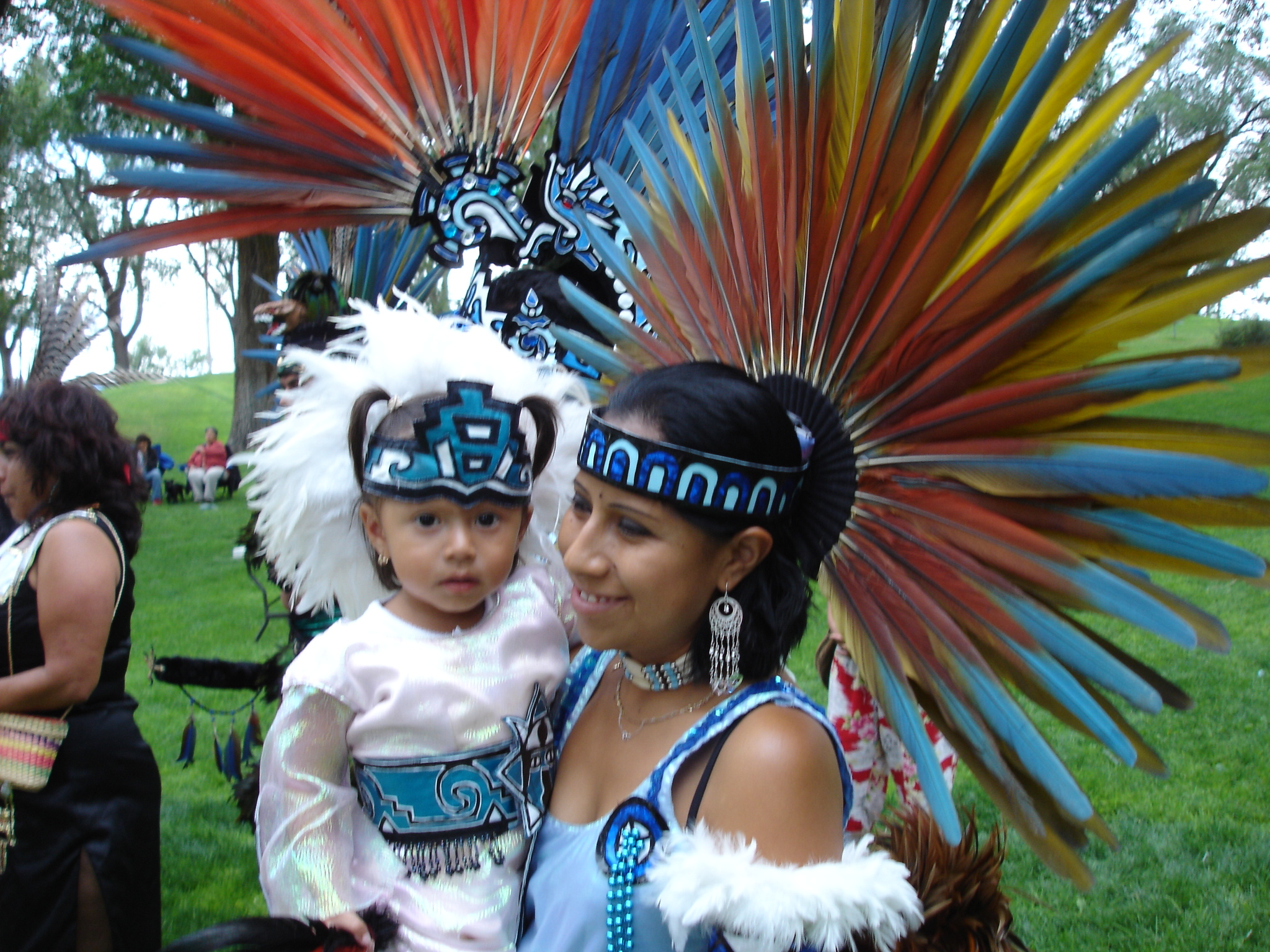 Emanating beauty, a mother and daughter dress in full regalia to welcome Hopi and Aztec runners